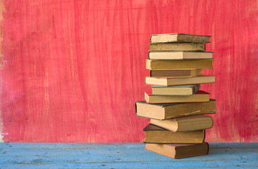 stack of books on a wooden shelf, free copy space
