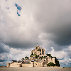 Mont Saint Michel ancient village with dramatic sky. Normandy, F