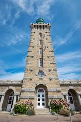 Cap Frehel lighthouse against blue cloudy sky.