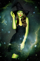 Beautiful young woman as halloween witch
