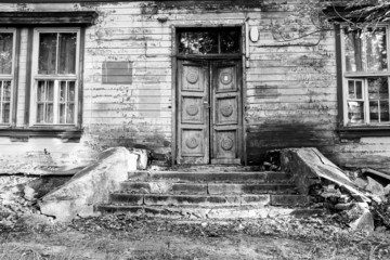 old wooden door with staircase black and white