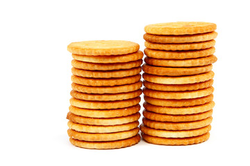 Stack of cracker biscuits isolated on a white background.