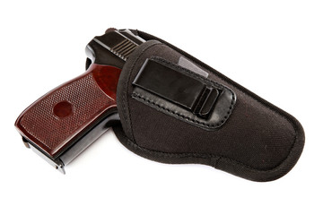 Gun in a holster on white background.