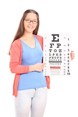 Young girl pointing on eyesight test with a stick
