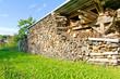 canvas print picture - Holzlager auf der Wiese