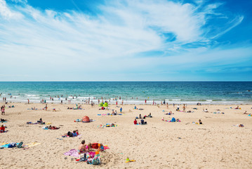People relaxing at the beach, France.