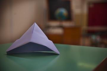 Paper hat in empty classroom
