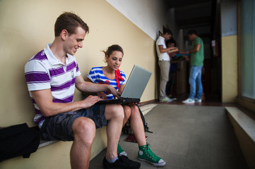 Students at school with laptop