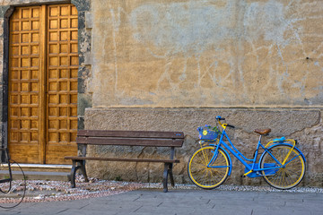 vintage bicycle near wooden bench