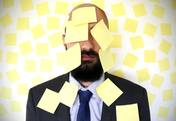 Man with Face Covered in Yellow Sticky Notes Reminders