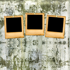 Old paper slides on the shabby brick wall background