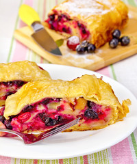 Strudel with black currants on the tablecloth