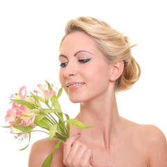 portrait of a beautiful blonde with flowers