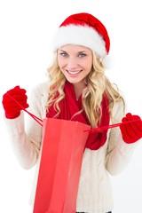 Festive blonde holding shopping bag