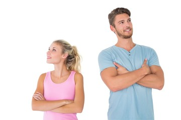Young couple posing with arms crossed