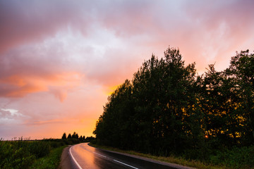 Sunset and road after rain