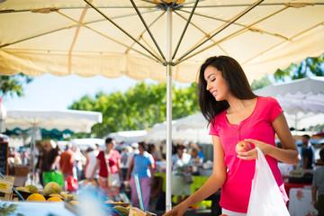healthy woman shopping farmer's market organic fruits vegetables