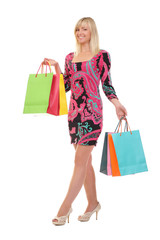 woman with shopping bags against white background