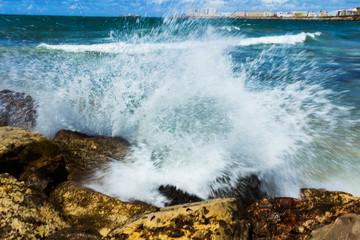Waves splashing rocks