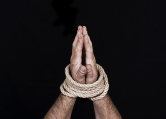 Men's hands tied rope
