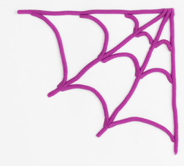 Spider Web from children bright plasticine - Stock Image macro.
