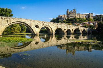 Béziers - view of the city across the river and the old bridge,
