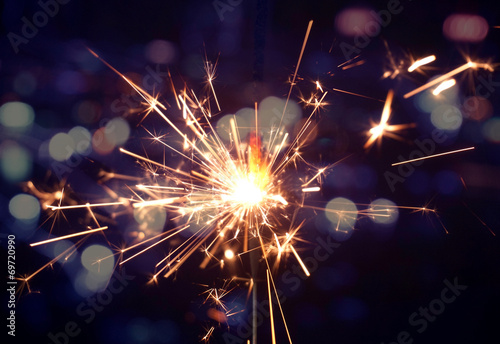 holiday background with a sparkler - 69720990