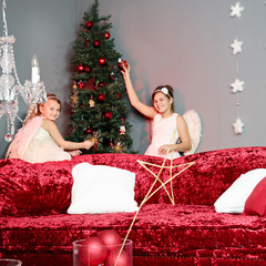 Two angels decorate the Christmas tree