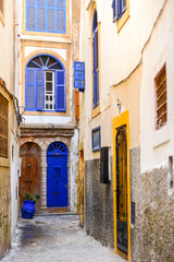 Narrow traditional street with buildings with colorful doors