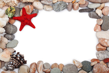 Red starfish and  multicoloured pebbles isolated on white backgr