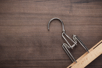 clothing hanger on brown table