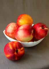 Nectarines in a plate.
