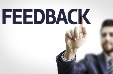 Business man pointing the text: Feedback