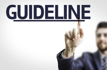 Business man pointing the text: Guideline