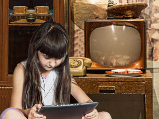 Caucasian child kid girl sister in old home with tablet pc