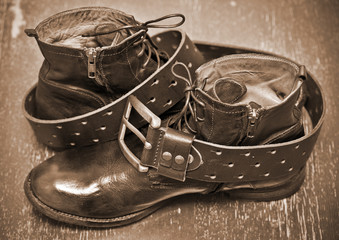 luxury leather shoes and a leather belt. cowboy style. vintage