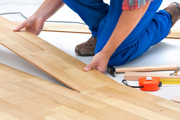 Man laying laminate flooring