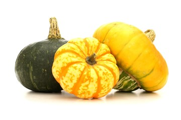 Group of autumn squash over a white background