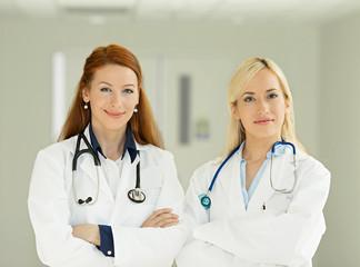 Confident two female doctors, healthcare professionals, nurses