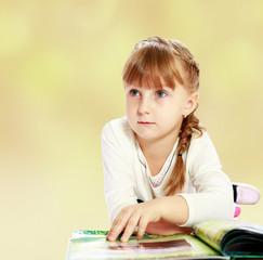 girl leafing through the book.