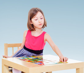 girl enthusiastically lays out cards