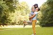 Happy couple has a fun in summer park