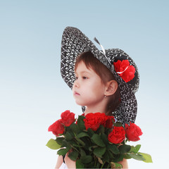 charming girl with a bouquet of red roses portrait profile.