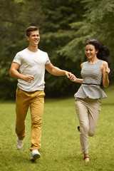 Couple in Love. Happy Couple Running in the park