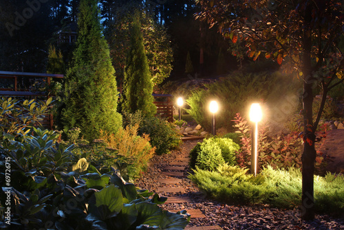 Foto op Plexiglas Tuin Illuminated garden path patio