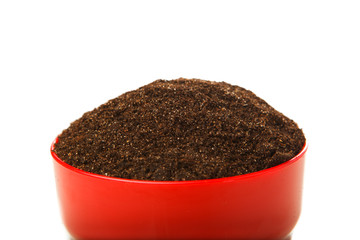 soil in the red pot, isolated on white
