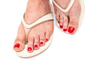 a female foot in thongs
