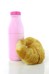 Strawberry flavor milk and croissant