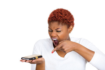 Angry woman yelling on mobile phone, white background