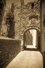 Vintage photo of old street in ordinary Catalan town